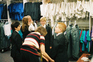 Philip (center) and Colorado Children's Chorale wardrobe closet