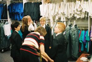 Philip (center) and Colorado Children's Chorale wardrobe closet